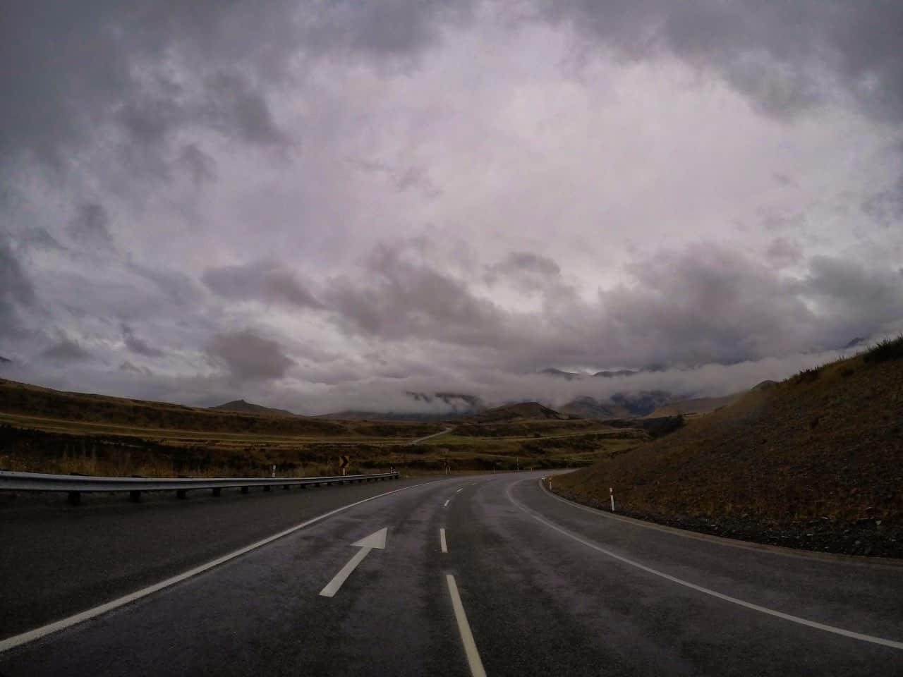 Arthurs-Pass-New-Zealand-rainy-day-Road-with-marks