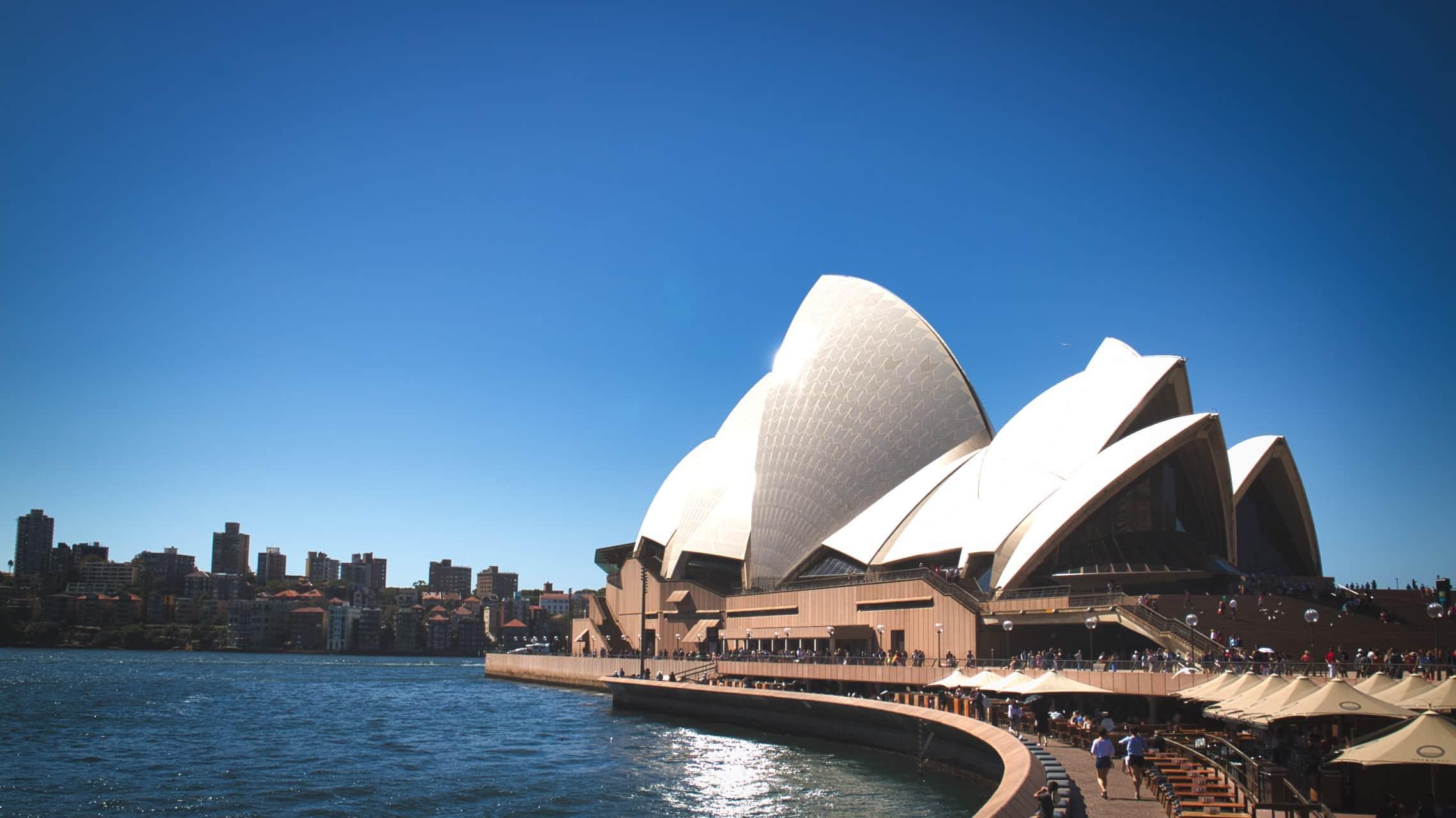 Sydney Opera House shining Sun blue sky