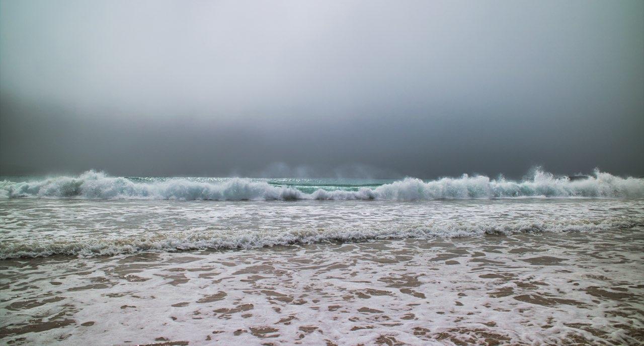 Curio-Bay-Beach-waves-cloudy-sky